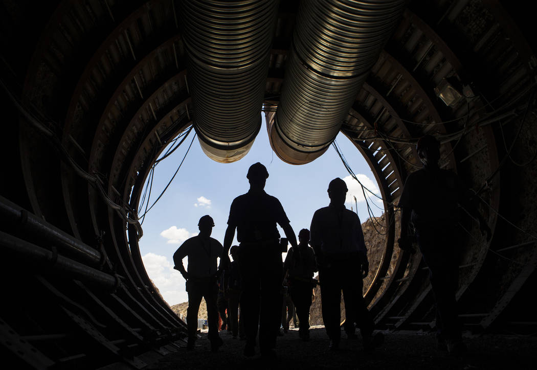Members of a congressional tour make their way through the south portal of Yucca Mountain near Mercury, July 14, 2018. (Chase Stevens/Las Vegas Review-Journal) @csstevensphoto