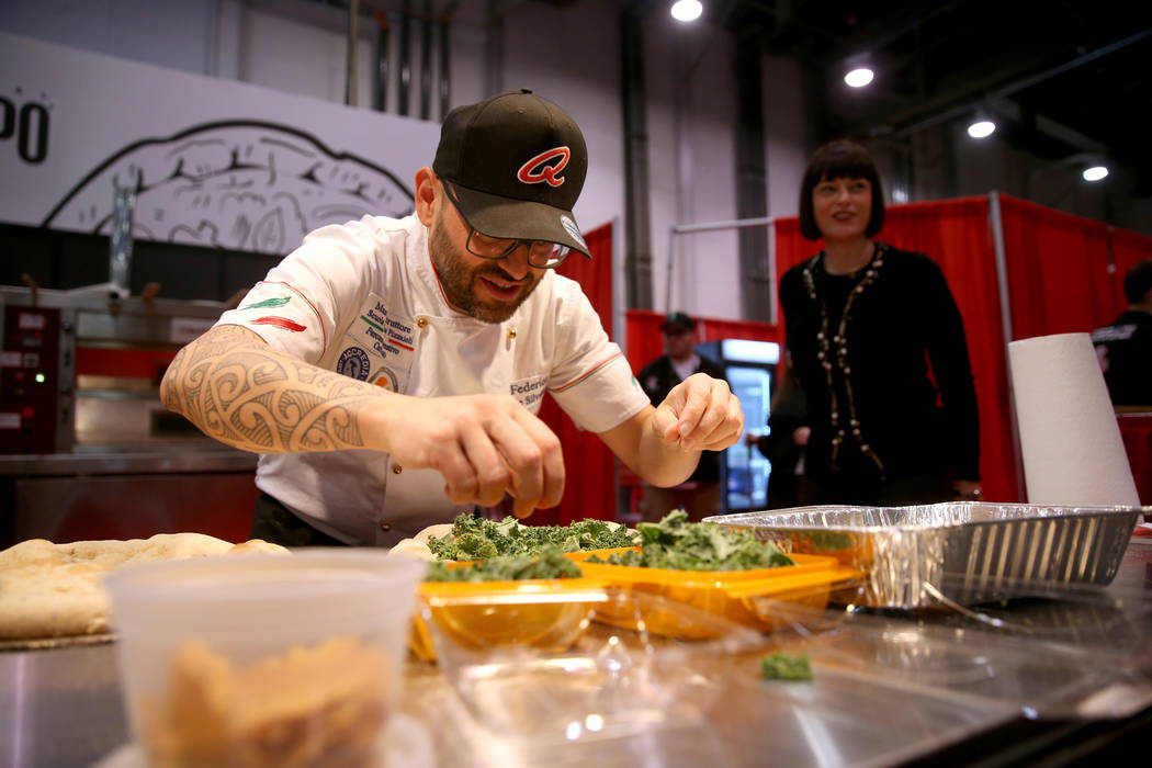 Federico De Silvestri of Verona, Italy, competes in the finals for the non-traditional pizza category during the International Pizza Challenge at the International Pizza Expo at the Las Vegas Conv ...