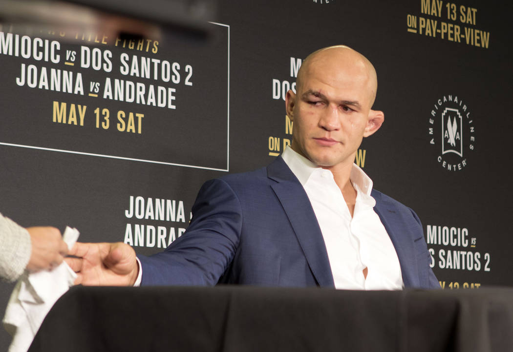 Junior dos Santos shows emotion during the UFC 211 post-fight press conference after being knocked out by UFC heavyweight champion Stipe Miocic at the American Airlines Center in Dallas, Texas, on ...