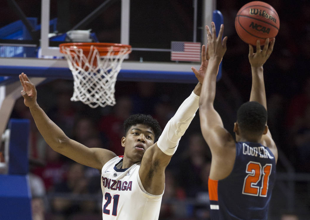 Gonzaga junior forward Rui Hachimura (21) extends to block the shot of Pepperdine senior guard Eric Cooper Jr. (21) in the first half during the West Coast Conference semifinal game on Monday, Mar ...
