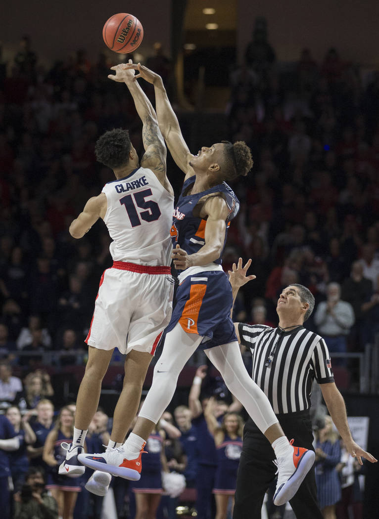 Gonzaga junior forward Brandon Clarke (15) leaps for the opening tip with Pepperdine freshman center Victor Ohia Obioha (34) in the first half during the West Coast Conference semifinal game on Mo ...
