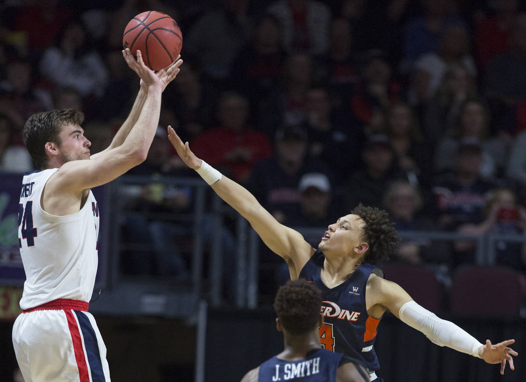 Gonzaga sophomore forward Corey Kispert (24) shoots a corner three over Pepperdine sophomore guard Colbey Ross (4) in the second half during the West Coast Conference semifinal game on Monday, Mar ...