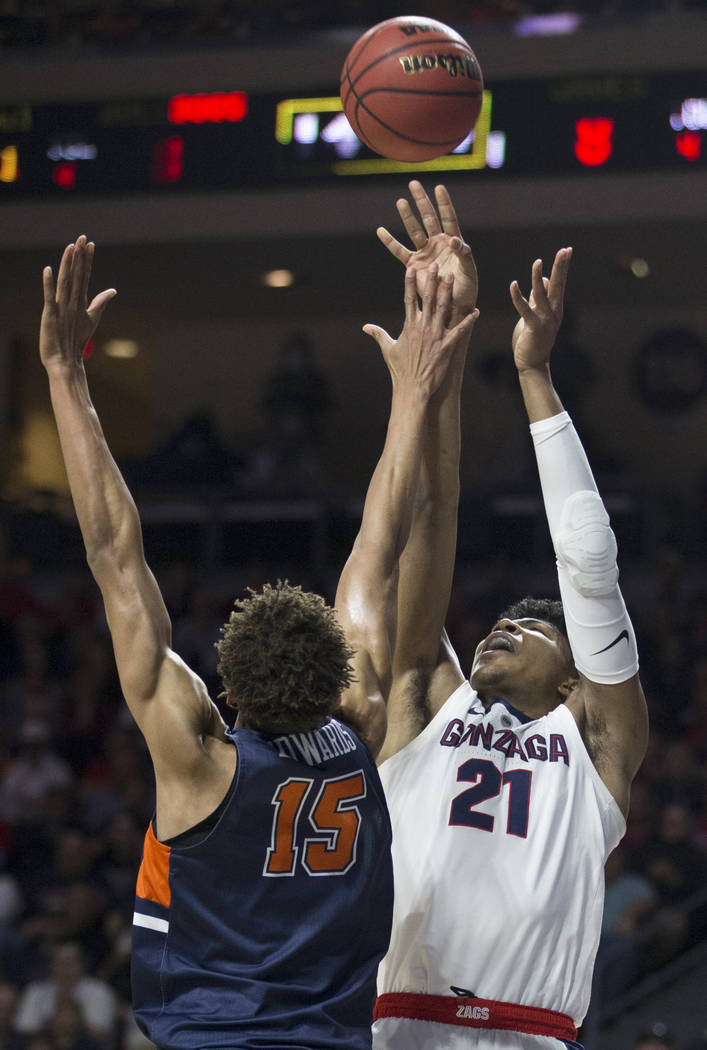 Gonzaga junior forward Rui Hachimura (21) shoots a corner jump shot over Pepperdine freshman forward Kessler Edwards (15) in the first half during the West Coast Conference semifinal game on Monda ...