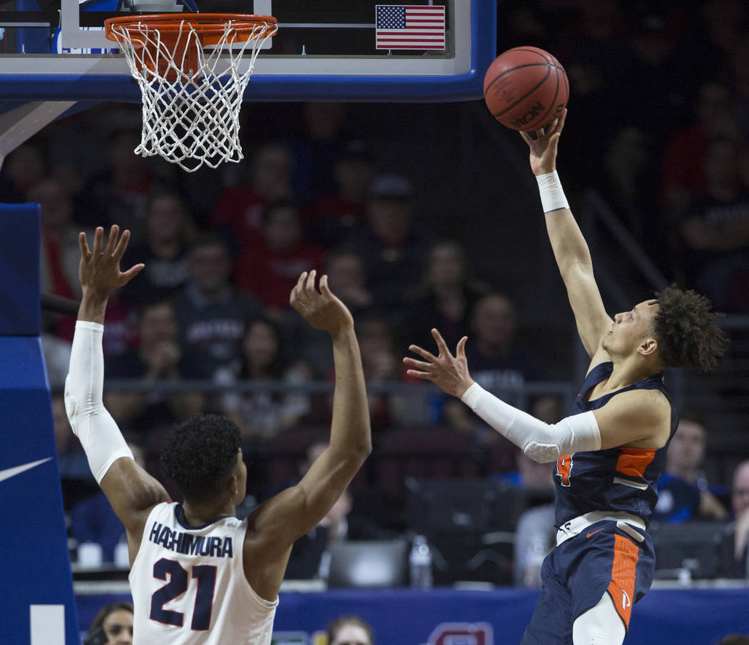 Pepperdine sophomore guard Colbey Ross (4) slices to the rim past Gonzaga junior forward Rui Hachimura (21) in the first half during the West Coast Conference semifinal game on Monday, March 11, 2 ...