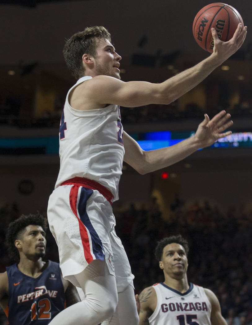 Gonzaga sophomore forward Corey Kispert (24) drives past Pepperdine senior forward Darnell Dunn (12) in the first half during the West Coast Conference semifinal game on Monday, March 11, 2019, at ...