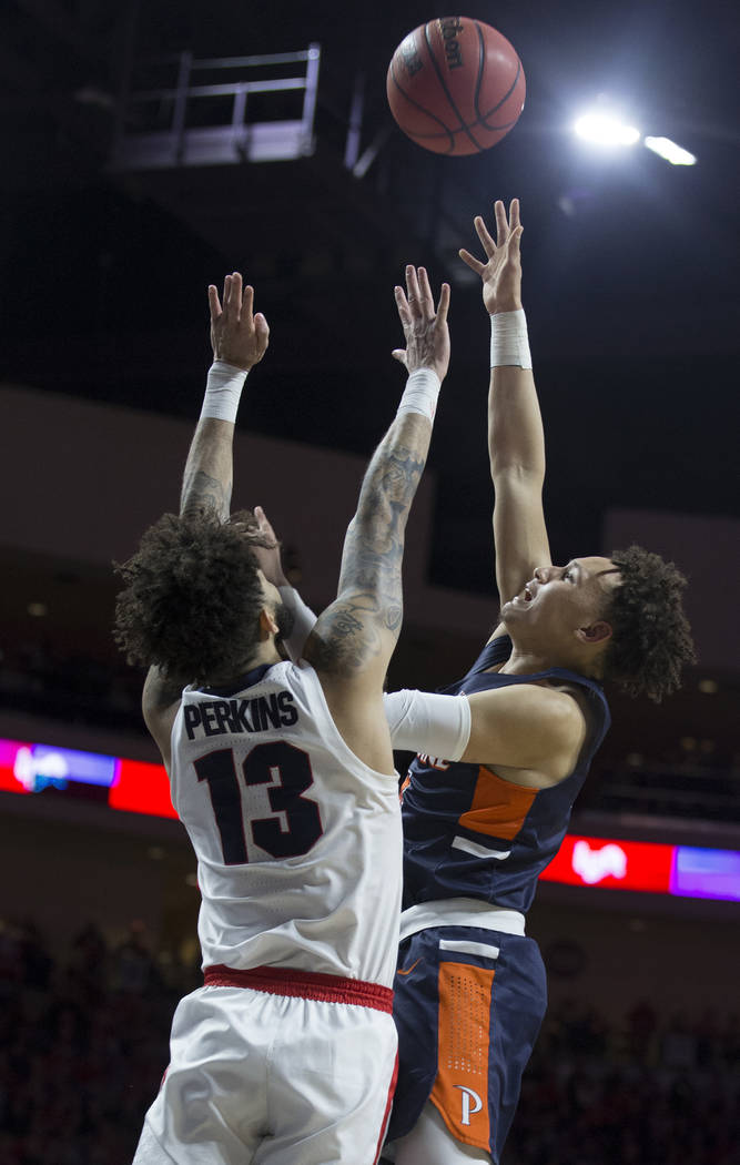 Pepperdine sophomore guard Colbey Ross (4) shoots over Gonzaga senior guard Josh Perkins (13) in the second half during the West Coast Conference semifinal game on Monday, March 11, 2019, at Orlea ...