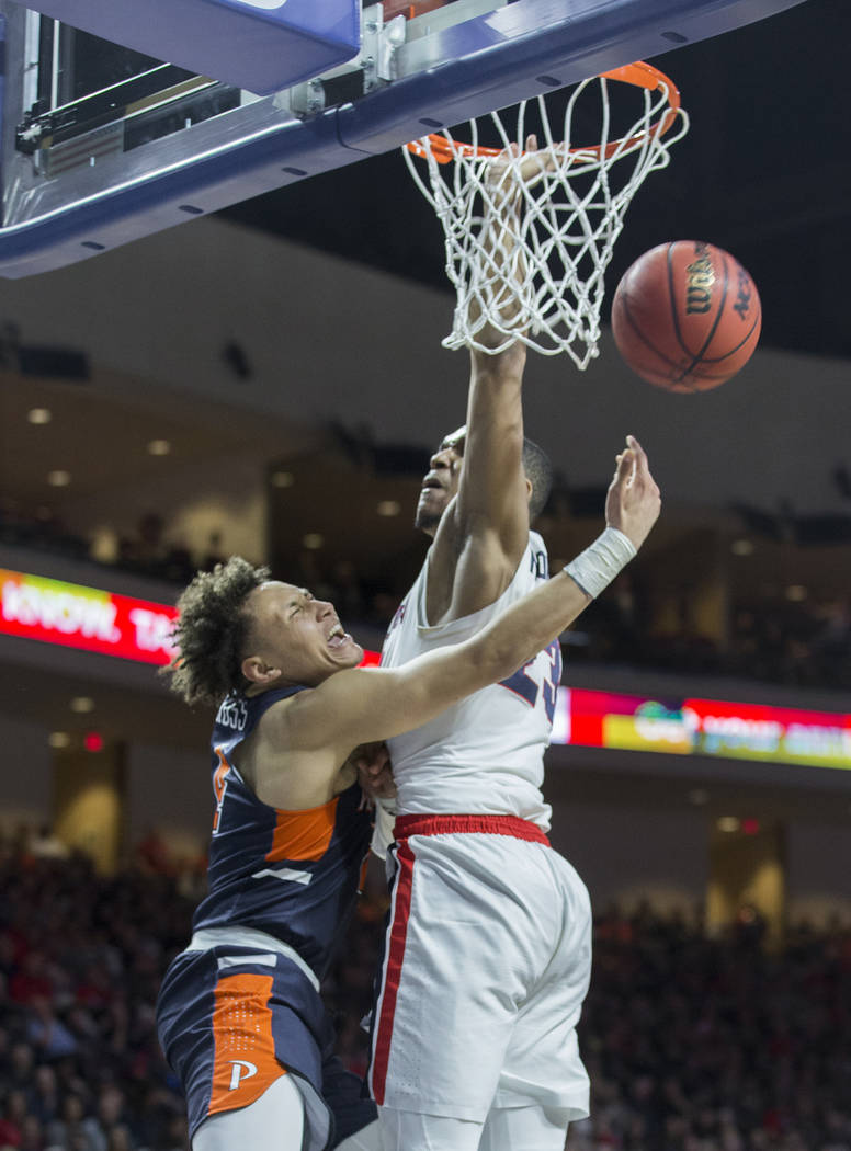Pepperdine sophomore guard Colbey Ross (4) gets fouled by Gonzaga sophomore guard Zach Norvell Jr. (23) in the second half during the West Coast Conference semifinal game on Monday, March 11, 2019 ...