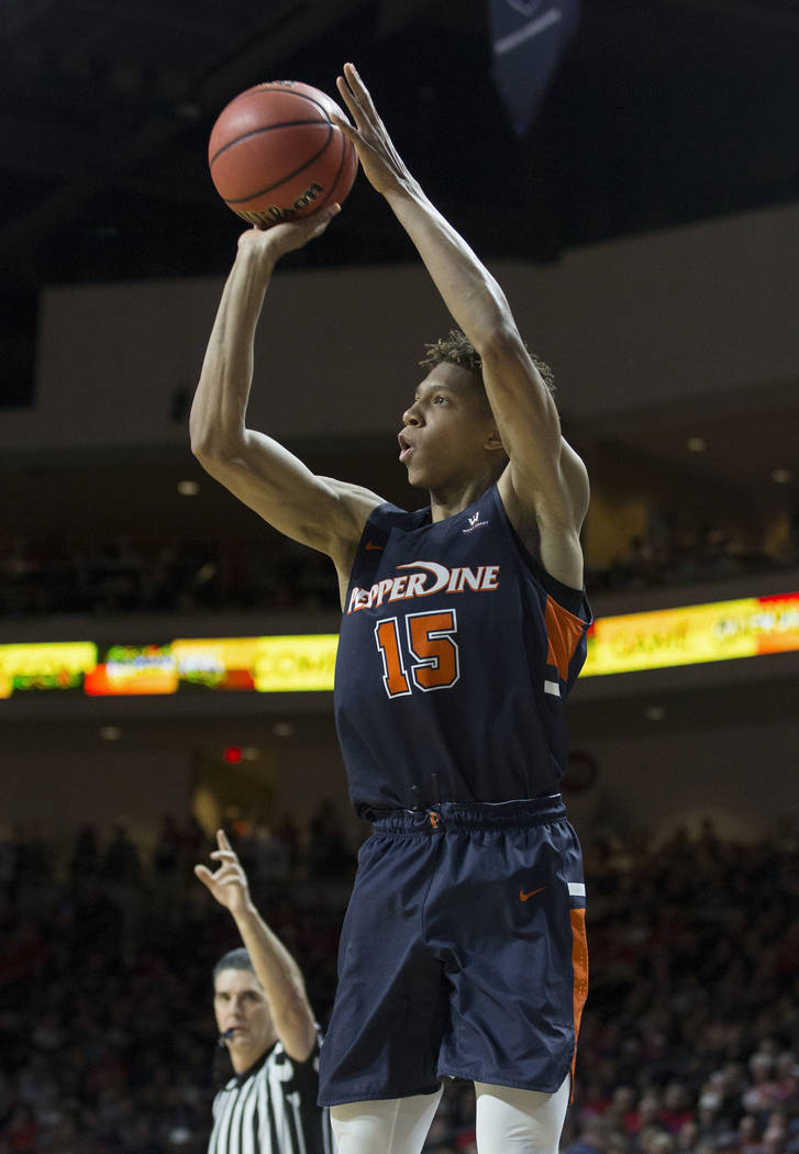 Pepperdine freshman forward Kessler Edwards (15) shoots a corner three in the second half during their West Coast Conference semifinal game with Gonzaga on Monday, March 11, 2019, at Orleans Arena ...