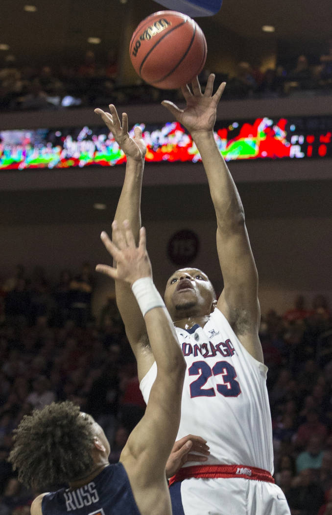 Gonzaga sophomore guard Zach Norvell Jr. (23) shoots over Pepperdine sophomore guard Colbey Ross (4) in the first half during the West Coast Conference semifinal game on Monday, March 11, 2019, at ...