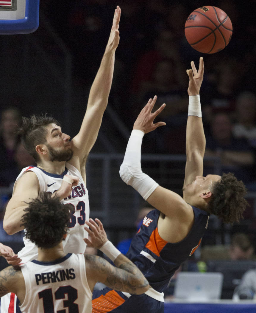 Pepperdine sophomore guard Colbey Ross (4) shoots over Gonzaga junior forward Killian Tillie (33) in the first half during the West Coast Conference semifinal game on Monday, March 11, 2019, at Or ...