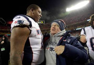 New England Patriots offensive tackle Trent Brown (77) celebrates with head coach Bill Belichick after defeating the Kansas City Chiefs in the AFC Championship NFL football game, Sunday, Jan. 20, ...