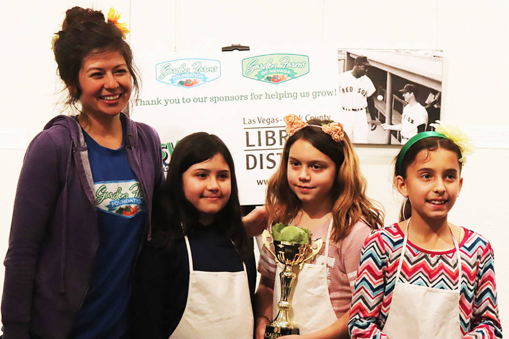 From left, Vanessa Portillo, Payton Gallow, Jayden Iurato, and Camila Godinez after the presenting of the Cabbage Bowl at the student farmers market at the Summerlin Library on March 2. (Garden Farms)