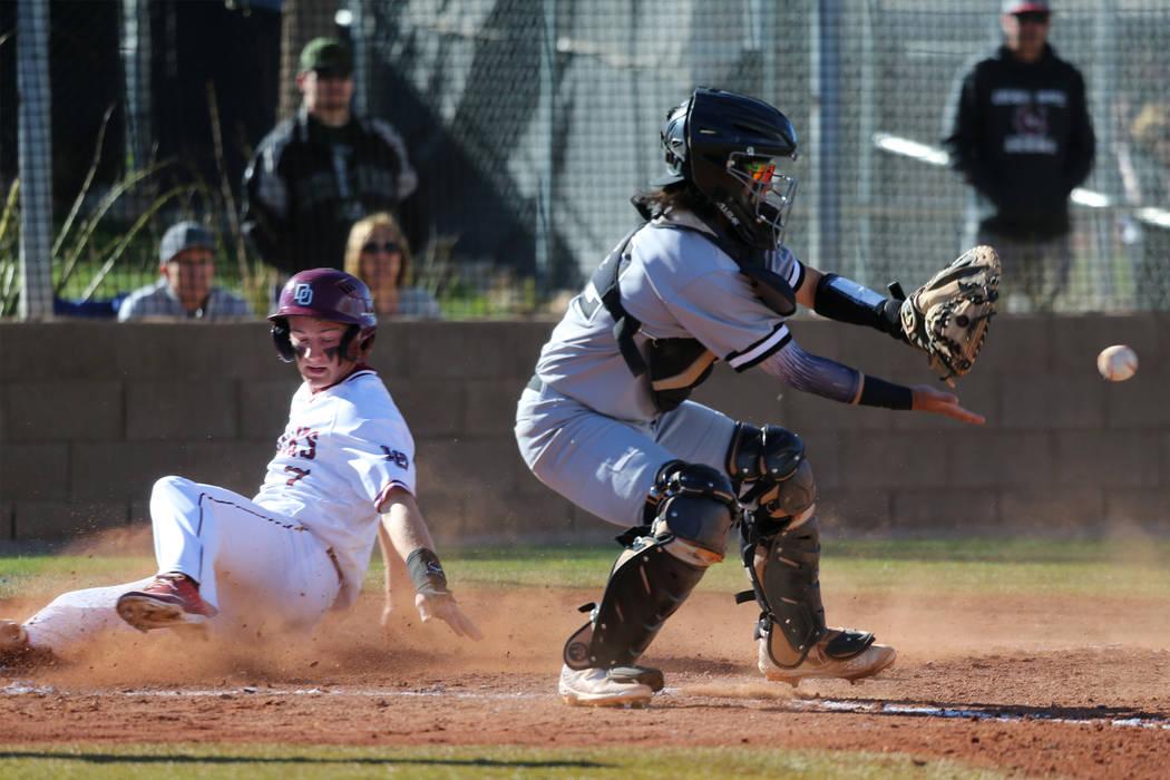 Desert Oasis' Colton Zobrist (7) slides home for a run against Palo Verde's Yuta Nakamura (52) in the baseball game at Desert Oasis High School in Las Vegas, Tuesday, March 12, 2019. Erik Verduzco ...