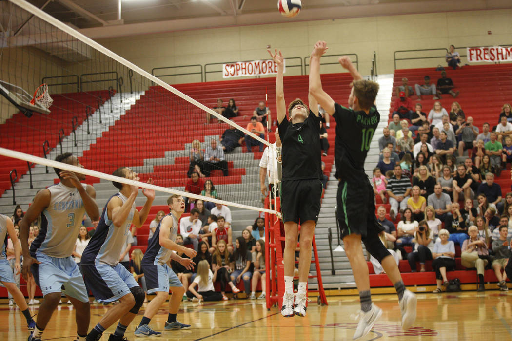 Palo Verde High School's Jared Brady (10) preps the ball for teammate Cooper Jarman (4) to spike it in the Sunset Region boys semifinal against Centennial High School at Arbor View High School in ...