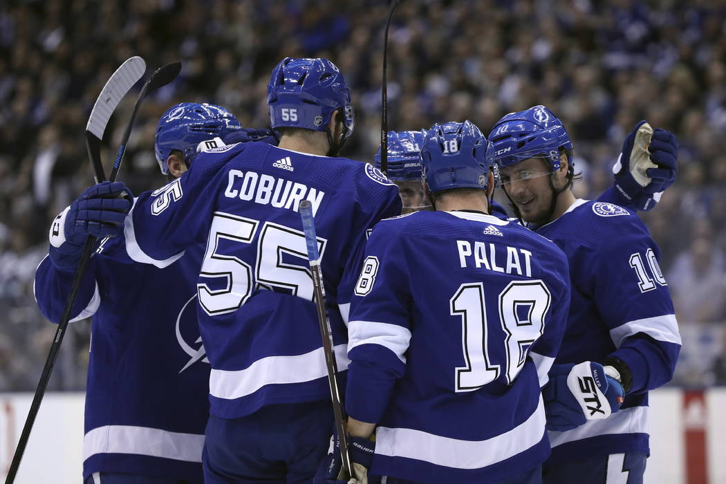 Tampa Bay Lightning defenseman Braydon Coburn (55), left wing Ondrej Palat (18), and center J.T. Miller (10) celebrate a second-period goal against the Toronto Maple Leafs in NHL hockey game actio ...