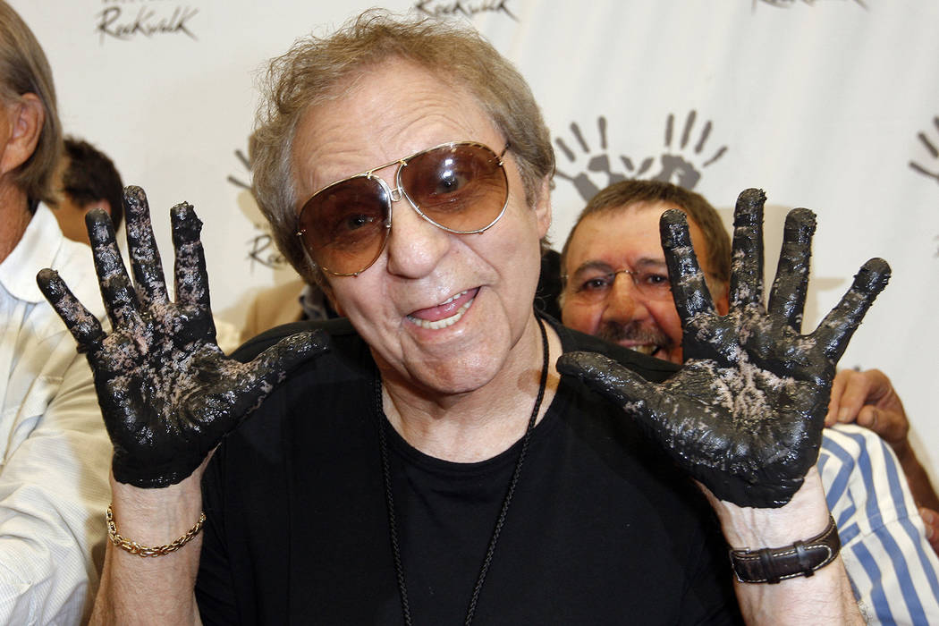 In this June 25, 2008, file photo, Hal Blaine holds up his hands covered in cement after placing them in wet cement with Don Randi and Glen Campbell, representing The Wrecking Crew following an in ...