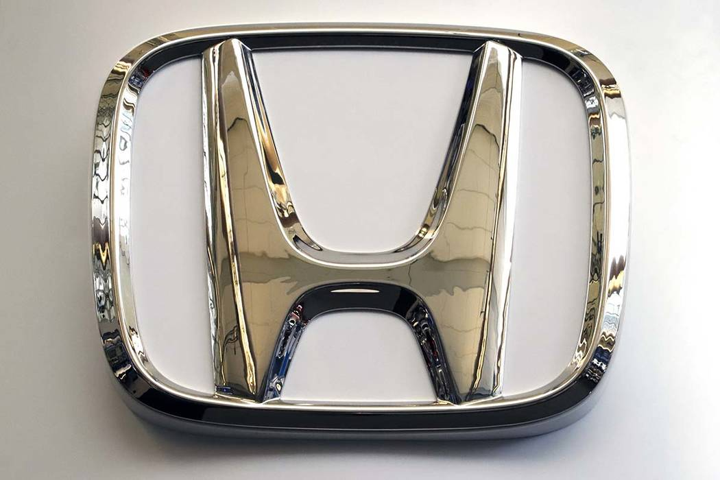 In this Feb. 14, 2019, photo, this photo shows the Honda logo on a sign at the 2019 Pittsburgh International Auto Show in Pittsburgh. (AP Photo/Gene J. Puskar)