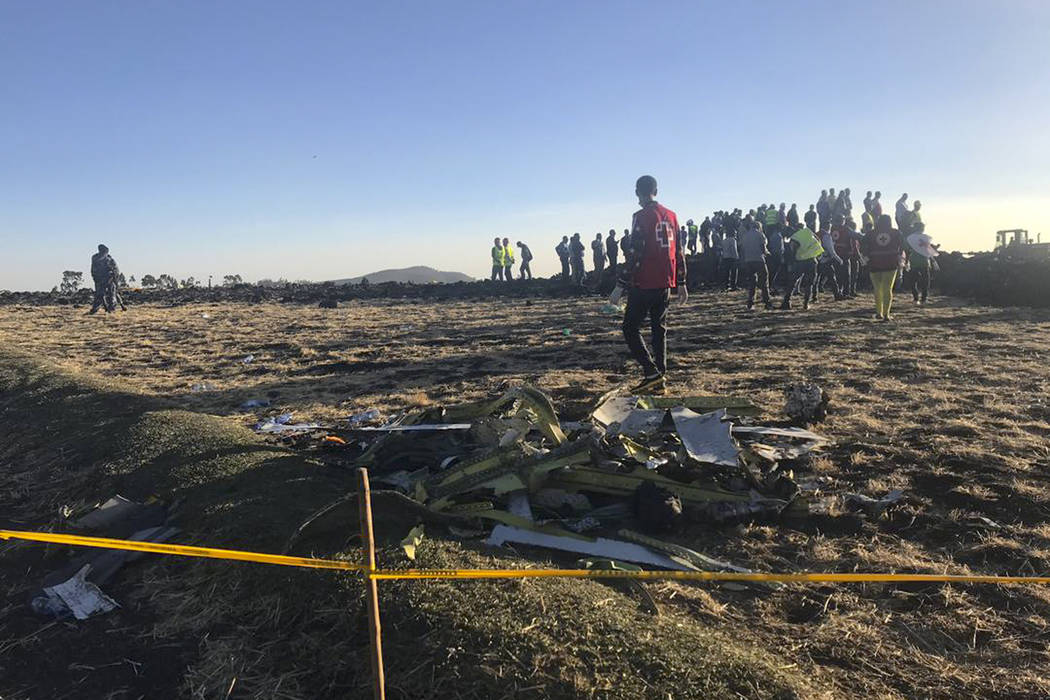 Rescuers search at the scene of an Ethiopian Airlines flight that crashed shortly after takeoff at the scene at Hejere near Bishoftu, or Debre Zeit, some 50 kilometers (31 miles) south of Addis Ab ...
