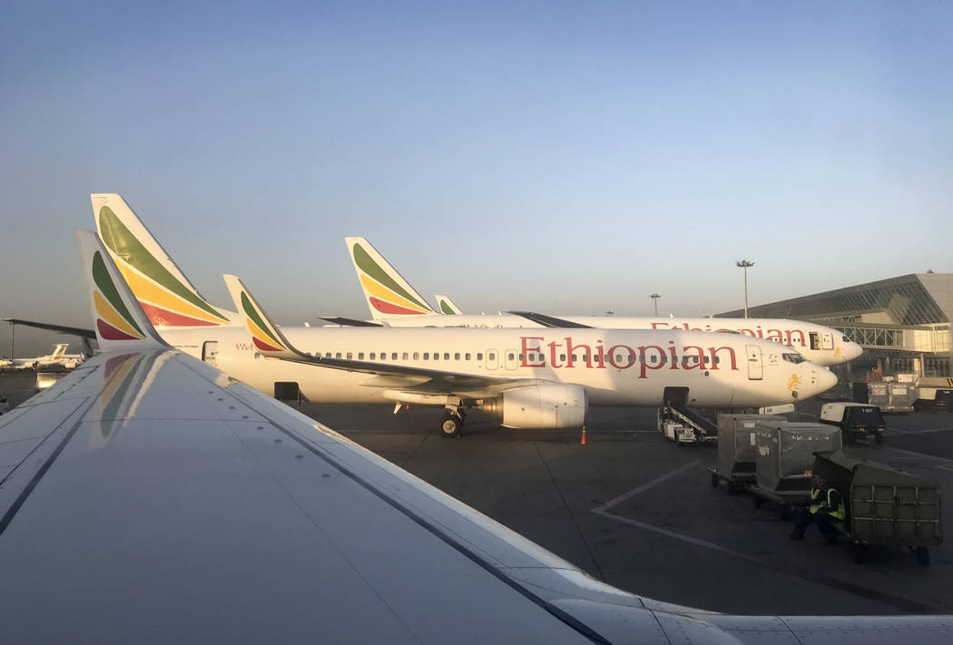 This photo taken Monday, Feb. 11, 2019 shows an Ethiopian Airlines Boeing 737-800 parked at Bole International Airport in Addis Ababa, Ethiopia. An Ethiopian Airlines Boeing 737 Max 8 jetliner car ...