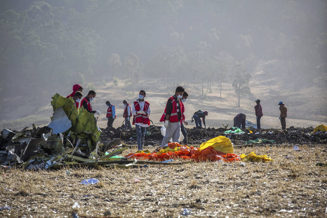 Rescuers work at the scene of an Ethiopian Airlines flight crash near Bishoftu, or Debre Zeit, south of Addis Ababa, Ethiopia, Monday, March 11, 2019. A spokesman says Ethiopian Airlines has grou ...