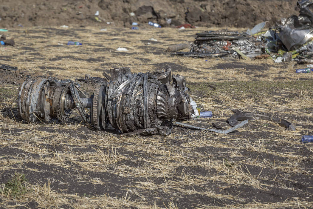 Airplane parts lie on the ground at the scene of an Ethiopian Airlines flight crash near Bishoftu, or Debre Zeit, south of Addis Ababa, Ethiopia, Monday, March 11, 2019. A spokesman says Ethiopia ...