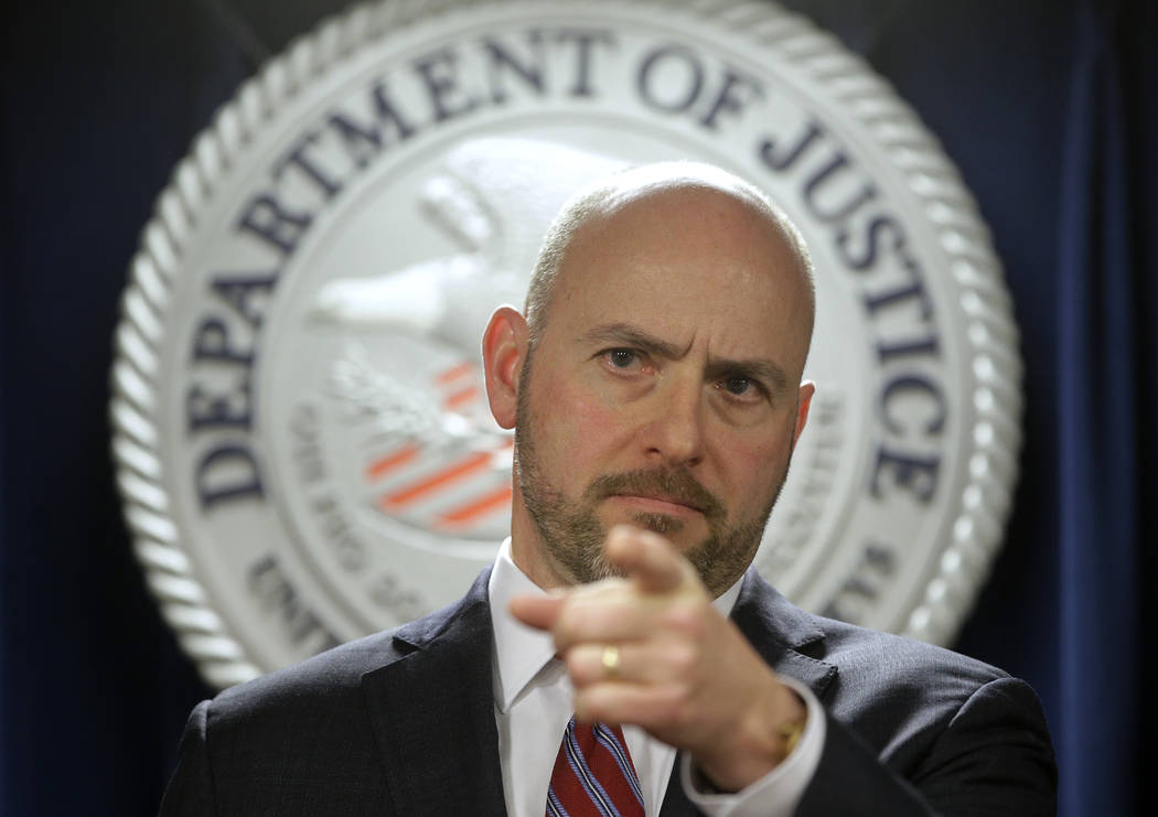 U.S. Attorney for District of Massachusetts Andrew Lelling announces indictments in a sweeping college admissions bribery scandal, during a news conference, Tuesday, March 12, 2019, in Boston. (AP ...