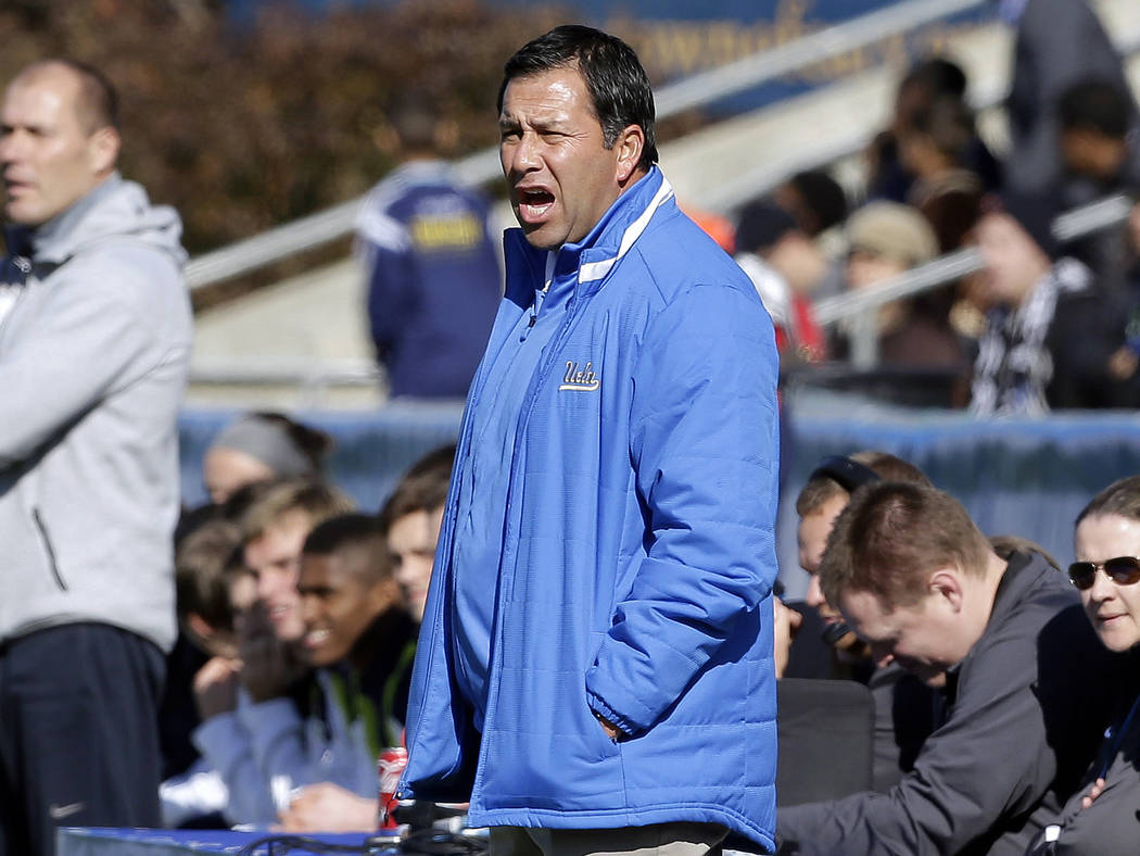 UCLA coach Jorge Salcedo reacts during the first half of an NCAA College Cup championship soccer game against Virginia in Cary, N.C., Dec. 14, 2014. Salcedo was charged along with nearly 50 other ...