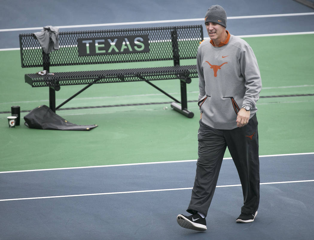 Texas men's tennis coach Michael Center surveys the courts before the matches with UTSA, in Austin, Texas, January 2018. Center is among a few people in the state charged in a scheme that invol ...