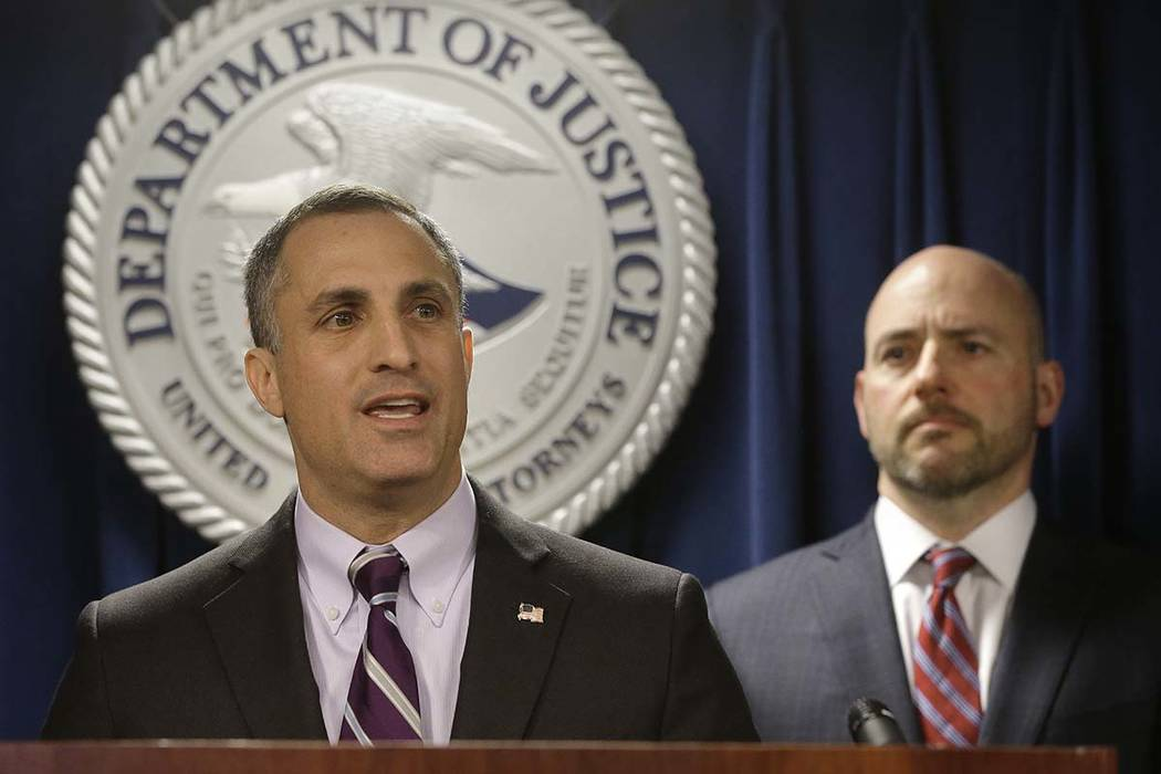 FBI Special Agent in Charge Boston Division Joseph Bonavolonta, left, and U.S. Attorney for District of Massachusetts Andrew Lelling face reporters as they announce indictments in a sweeping colle ...