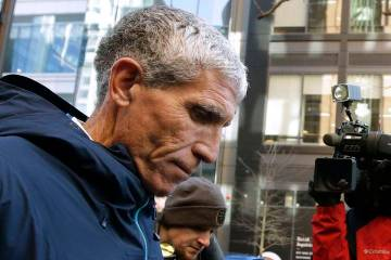 """William """"Rick"""" Singer, founder of the Edge College & Career Network, departs federal court in Boston on Tuesday, March 12, 2019, after he pleaded guilty to charges in a nationwide college admissio ..."""