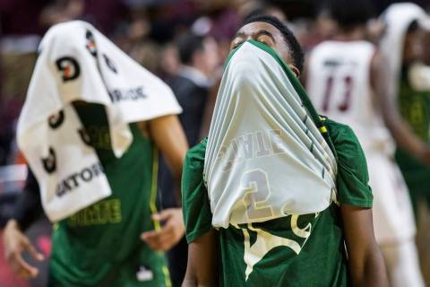 Chicago State senior guard Delshon Strickland (2) walks off the court with his face covered after the Cougars lost to New Mexico State 86-49 in the opening round of the Western Athletic Conference ...