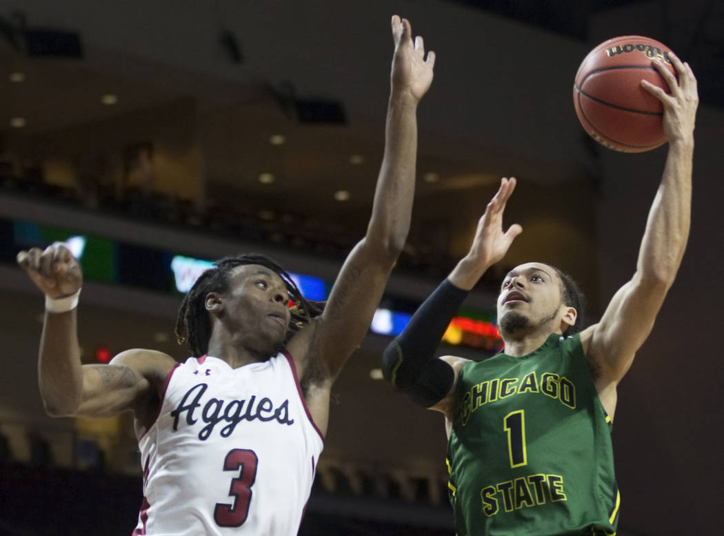 Chicago State senior guard Rob Shaw (1) slices to the rim past New Mexico State junior guard Terrell Brown (3) in the first half of the opening round of the Western Athletic Conference tournament ...