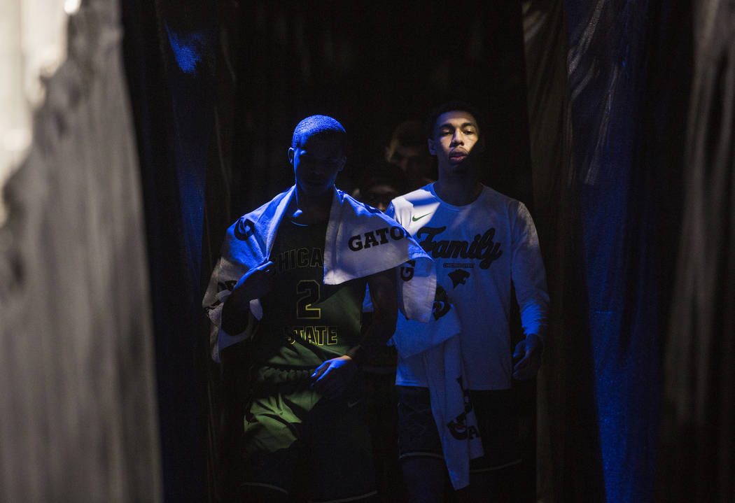 Chicago State senior guard Delshon Strickland (2) and sophomore forward Cameron Bowles (21) walk out of the locker room at the start of the second half of their opening round Western Athletic Con ...