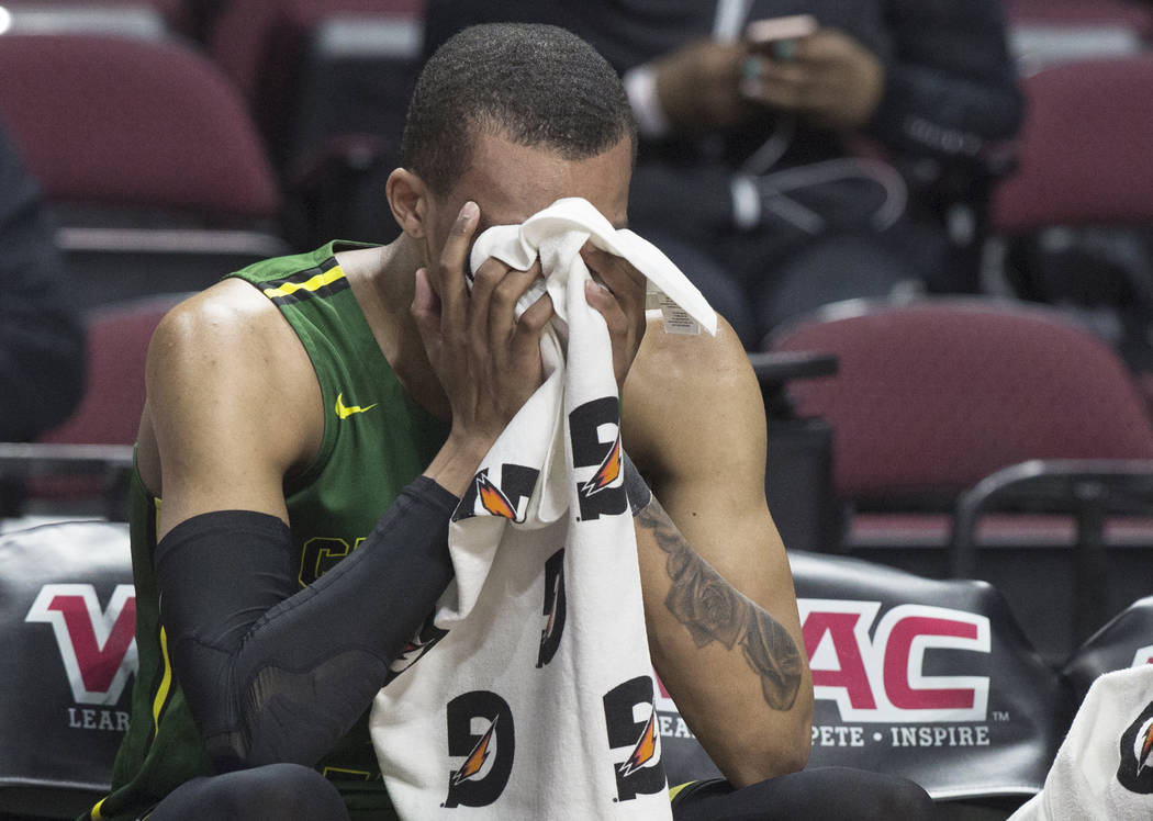 Chicago State senior guard Delshon Strickland (2) covers his face on the bench after the Cougars lost to New Mexico State 86-49 in the opening round of the Western Athletic Conference tournament ...
