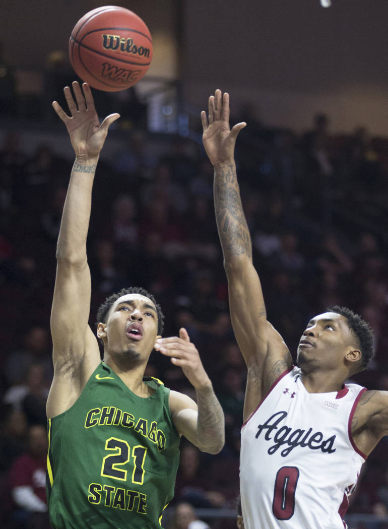 Chicago State sophomore forward Cameron Bowles (21) shoots a jump hook over New Mexico State freshman forward Berrick JeanLouis (0) in the second half of the opening round of the Western Athletic ...
