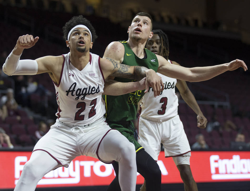 Chicago State junior forward Patrick Szpir (23) fights for position with New Mexico State senior forward Eli Chuha (22) and junior guard Terrell Brown (3) in the second half of the opening round o ...