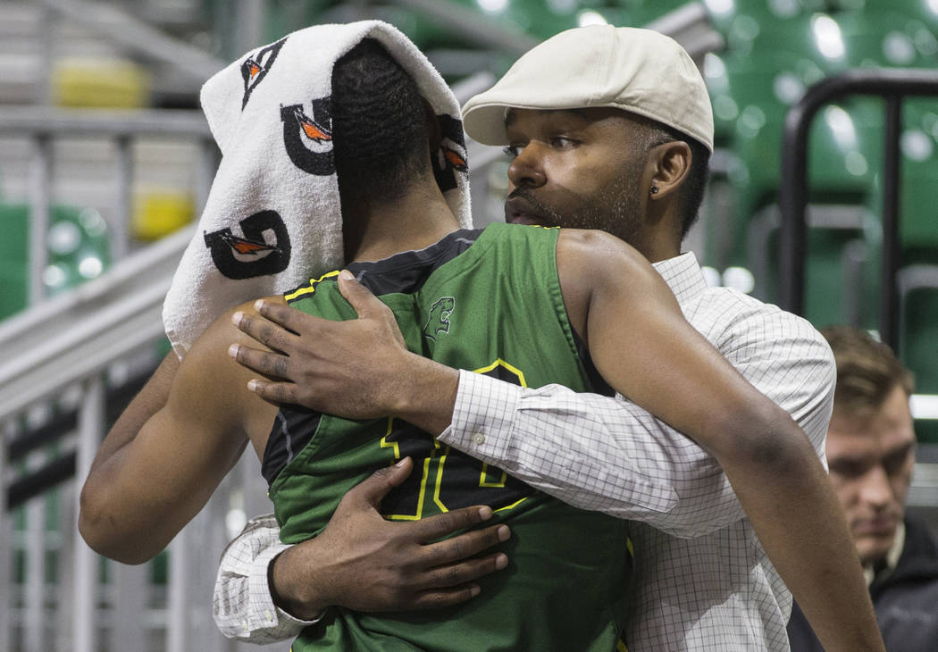 Chicago State senior guard Anthony Harris (10) gets a hug from a family member after the Cougars lost to New Mexico State 86-49 in the opening round of the Western Athletic Conference tournament o ...