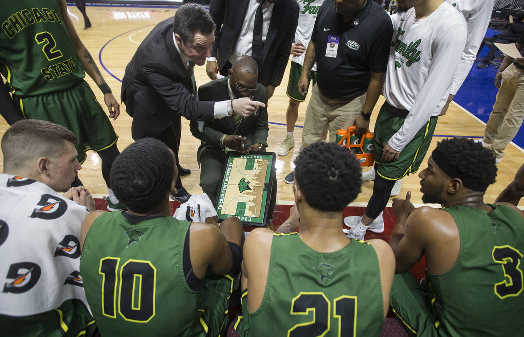 Chicago State gets coached up during a timeout in the second half during the Cougars opening round Western Athletic Conference tournament game with New Mexico State on Thursday, March 14, 2019, at ...
