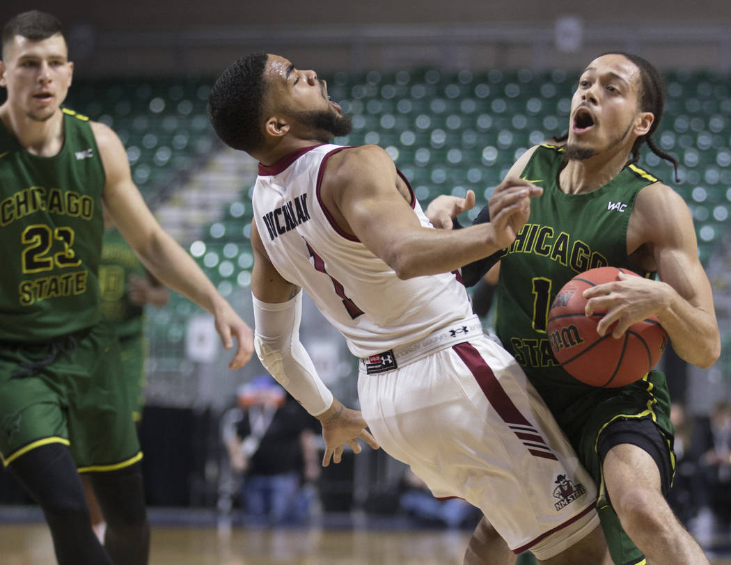 Chicago State senior guard Rob Shaw (1) collides with New Mexico State junior guard Shunn Buchanan (1) in the first half of the opening round of the Western Athletic Conference tournament on Thurs ...