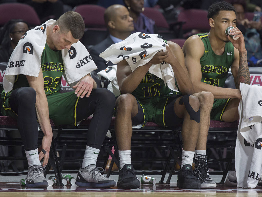 Chicago State junior forward Patrick Szpir (23), senior guard Anthony Harris (10) and junior forward Patrick Szpir (23) sit dejected on the bench as time winds down on a 86-49 loss to New Mexico S ...