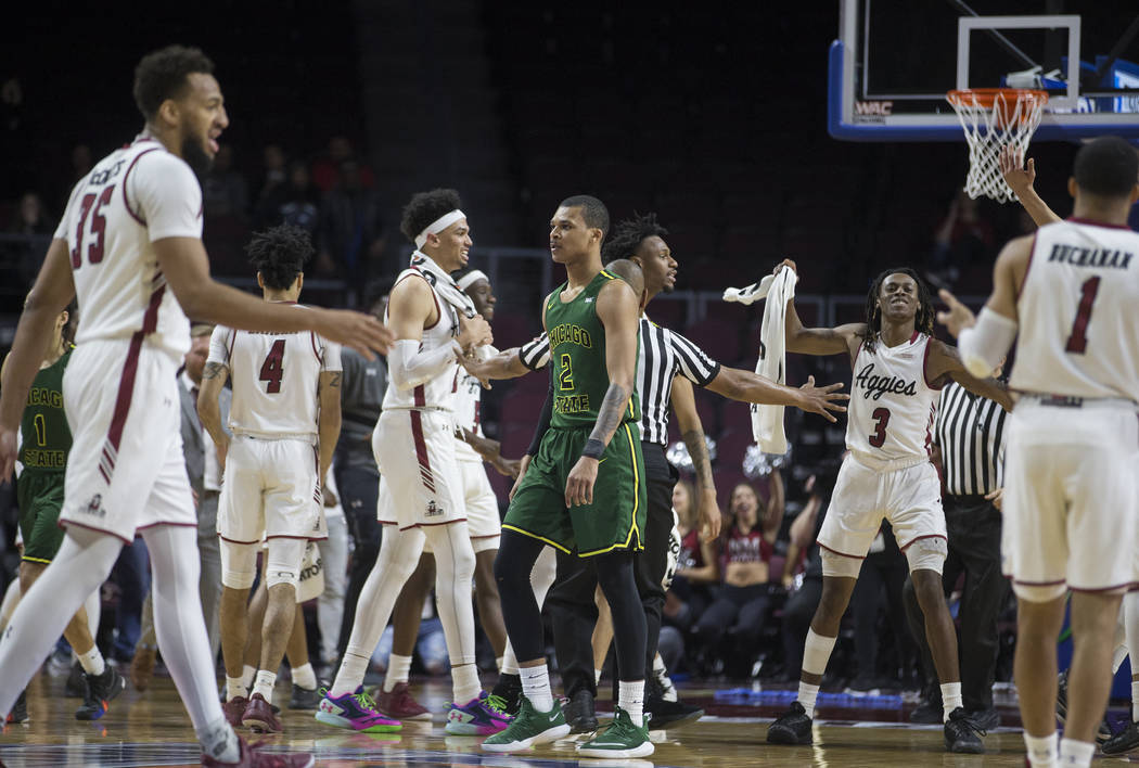 New Mexico State celebrates a big play as Chicago State senior guard Delshon Strickland (2) walks to the bench in the second half of the opening round of the Western Athletic Conference tournament ...