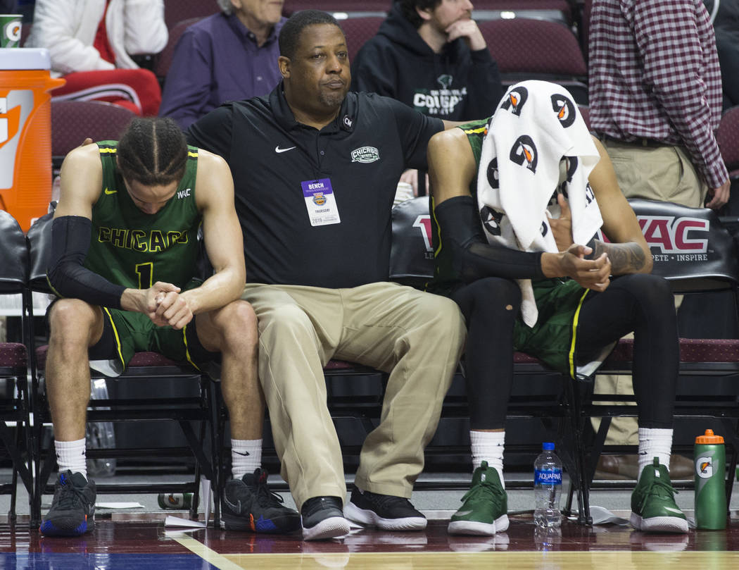 Chicago State senior guard Rob Shaw, left, and Chicago State senior guard Delshon Strickland, right, sit dejected on the bench as time winds down on a 86-49 loss to New Mexico State in the opening ...