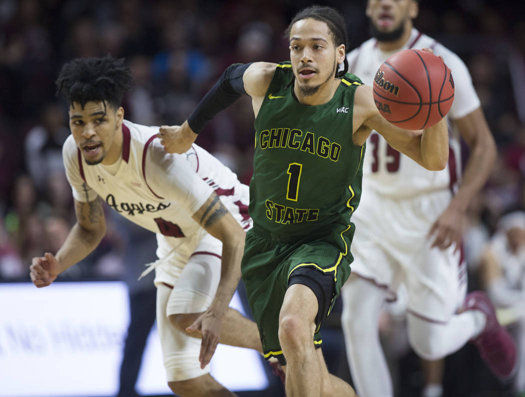 Chicago State senior guard Rob Shaw (1) pushes the ball up court past New Mexico State senior guard JoJo Zamora (4) in the second half of the opening round of the Western Athletic Conference tourn ...