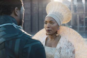 "Chadwick Boseman, left, and Angela Bassett in a scene from ""Black Panther."" (Disney/Marvel Studios via AP)"