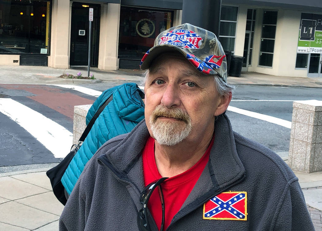 Howard Snow stands across from a Confederate statue in downtown Tuesday, March 12, 2019, in Winston-Salem, N.C. Snow says the city is wasting money by taking the statue down and that the money can ...