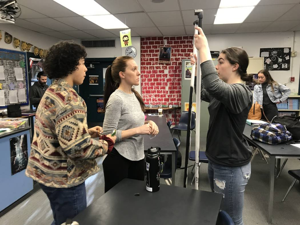 Dawn Minnick-Trujillo interacts with students during a robotics class on March 13 at the Las Vegas Academy of the Arts where she teaches physics and works as a robotics coach. She's one of three ...