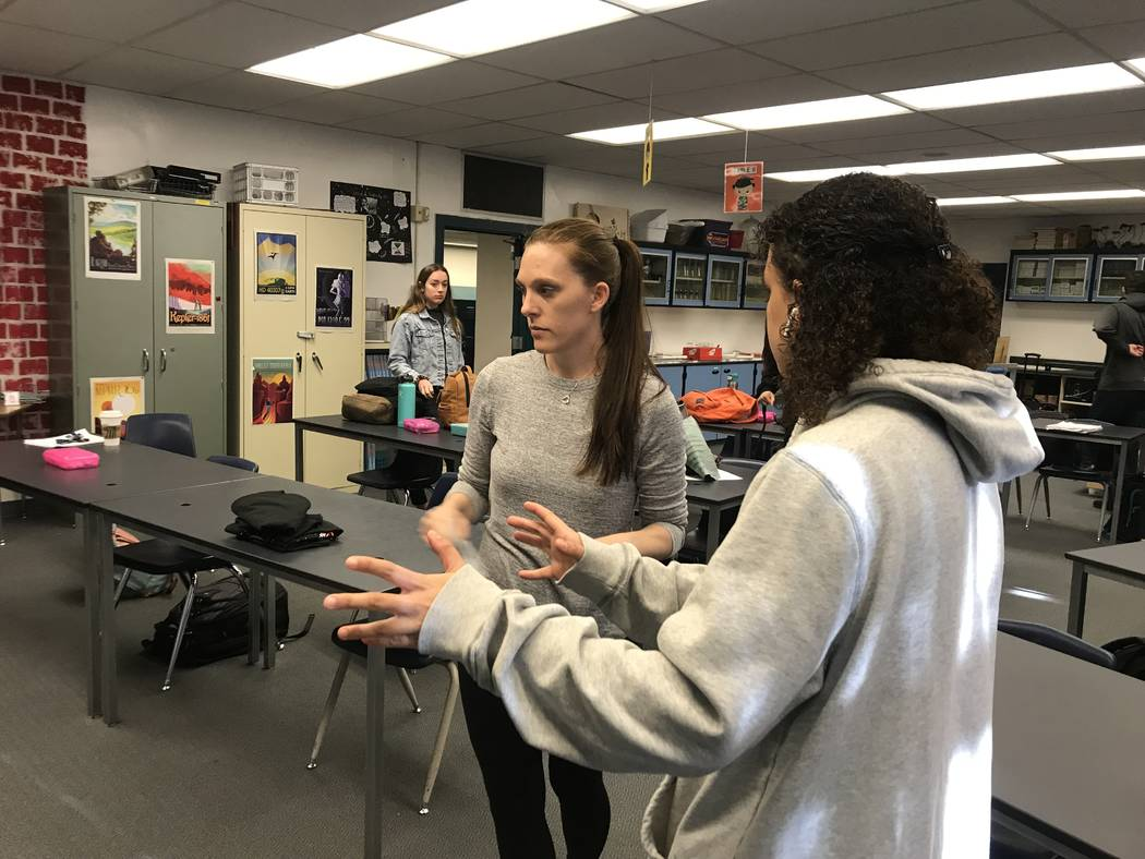 Dawn Minnick-Trujillo interacts with a student during a robotics class on March 13 at the Las Vegas Academy of the Arts where she teaches physics and works as a robotics coach. She's one of three ...