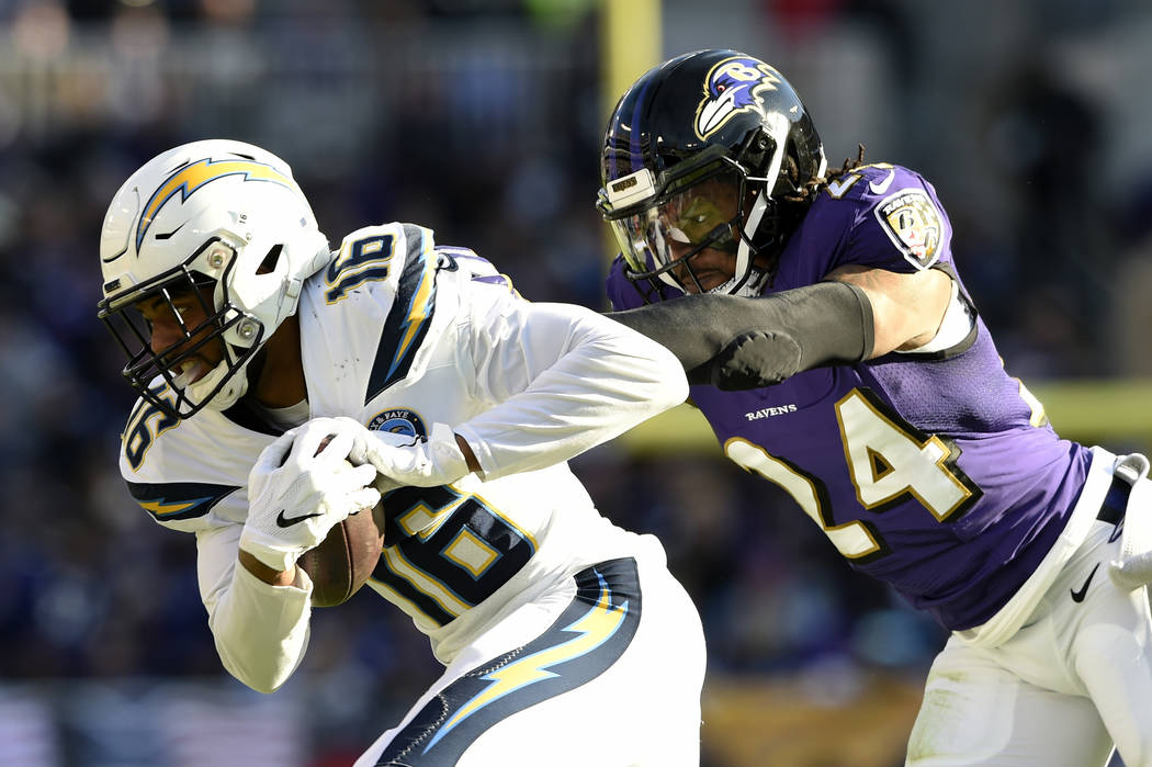 Los Angeles Chargers wide receiver Tyrell Williams, left, rushes past Baltimore Ravens cornerback Brandon Carr in the first half of an NFL wild card playoff football game, Sunday, Jan. 6, 2019, in ...