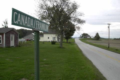 A sign marks the Canadian-U.S. border in Morse's Line, Vt. (AP Photo/Toby Talbot)
