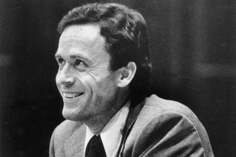 Ted Bundy smiles during the second day of jury selection for his murder trial in a Dade County courtroom in Miami, Fla. on June 27, 1979. (AP Photo)